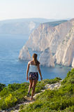 Woman on cliff of Zakynthos island - Agalas, Greece Stock Photography