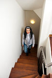 Woman climb interior stairs. Woman climb up interior wooden  stairs in her home Royalty Free Stock Photography