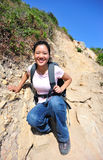 Woman climb mountain Stock Photo