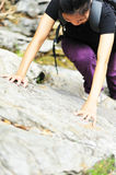 Woman climb rock Royalty Free Stock Images