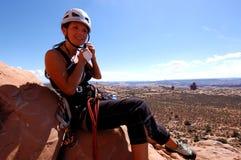 Woman climber. On summit of desert tower Stock Image