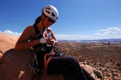 Woman climber. On summit of desert tower Royalty Free Stock Images