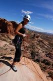 Woman climber. On summit of desert tower Stock Photos