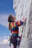 Woman climber. Climbs up the rock Royalty Free Stock Photo