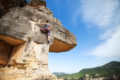 Woman climber on a cliff Stock Image