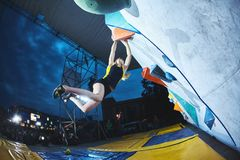 Woman climber on the climbing competition stock photo