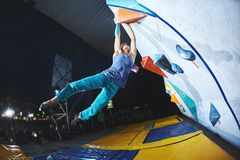 Woman climber on the climbing competition stock photos