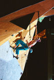 Woman climber climbs a with rope on climbing gym Royalty Free Stock Photos