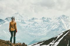 Woman climber enjoying snowy mountains view. Travel lifestyle adventure concept active vacations outdoor Royalty Free Stock Photography