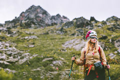 Woman climber hiking at rocky mountains Stock Image