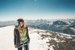 Woman climber reached Elbrus mountain summit. Travel Lifestyle success concept adventure active vacations outdoor happy emotions enjoying peaks range landscape Royalty Free Stock Photography