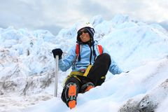 Woman climber resting on top of a glacier Royalty Free Stock Photo