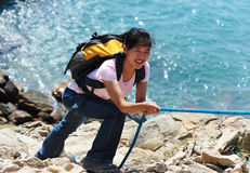 Woman climber seaside Royalty Free Stock Photos