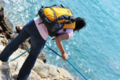 Woman climber seaside Stock Photo