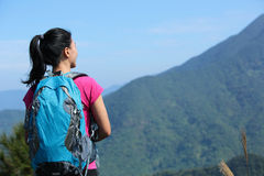 Woman climber stand mountain peak Royalty Free Stock Image