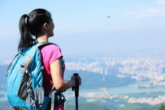 Woman climber stand mountain peak Stock Photography