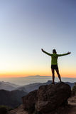 Woman climber success silhouette in inspiring mountains Royalty Free Stock Photos