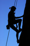 Woman climbing Royalty Free Stock Photos