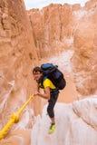 Woman climbing in canyon, Sinai, Egypt Stock Photo