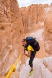 Woman climbing in canyon, Sinai, Egypt Stock Photos