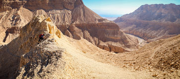 Woman climbing desert mountain ridge panorama. Stock Images