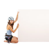 Woman in climbing equipment Stock Images