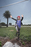 Woman climbing the fence Royalty Free Stock Images
