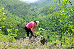 Woman climbing in the  green mountain Royalty Free Stock Photos