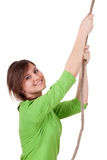 Woman climbing on grey rope Royalty Free Stock Photo