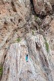 Woman climbing incredible wall. Stock Photo