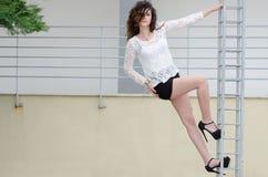 Woman climbing an iron frame Royalty Free Stock Photo