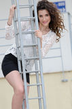 Woman climbing an iron frame Royalty Free Stock Photos