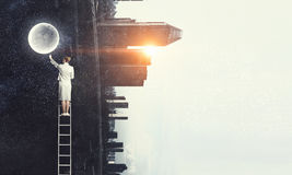 Woman climbing ladder Royalty Free Stock Images