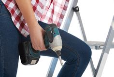 Woman climbing the ladder Stock Images