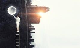 Woman climbing ladder . Mixed media Royalty Free Stock Photos