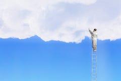 Woman climbing ladder . Mixed media Stock Photo