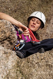 Woman during climbing the mountain Royalty Free Stock Images