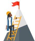Woman climbing on mountain Stock Image