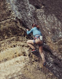 Woman climbing at the rock Royalty Free Stock Photo
