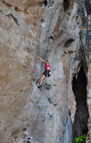 Woman climbing on the rock route summer Royalty Free Stock Photo