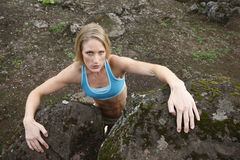 Woman climbing rocks Royalty Free Stock Photo