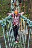 Woman climbing on a rope Stock Photos