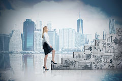 Woman climbing stairs and cityscape. Woman climbing stairs with startup icons against cityscape with skyscrapers. Concept of career ladder Stock Photos