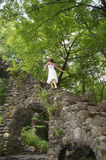 Woman climbing stairs. A woman climbs up this stone staircase located deep in the forest Royalty Free Stock Photo