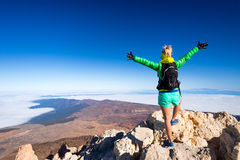 Woman climbing success in mountain top. Woman successful hiking climbing in mountains, motivation and inspirational landscape on island and ocean. Female hiker Stock Photos