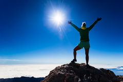 Woman climbing success silhouette on mountain top Stock Image