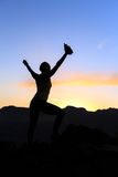 Woman climbing success silhouette in mountains sunset Stock Photography