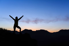 Woman climbing success silhouette in mountains sunset Royalty Free Stock Photo