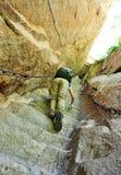 Woman climbing thousands steps at mount hua Stock Photos