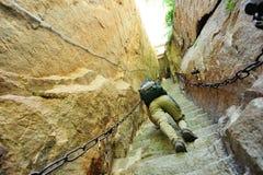 Woman climbing thousands steps at mount hua Stock Images